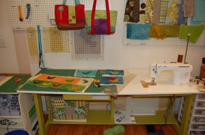 "With the ""mini-table"" in place, I can use the surface for cutting, or it will support a large quilt when I'm quilting."
