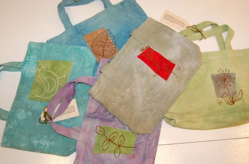 "Going Green Pockets Tote 13"" x 21/2"" x 81/2""  with single handle and 2 patch pockets on outside back"