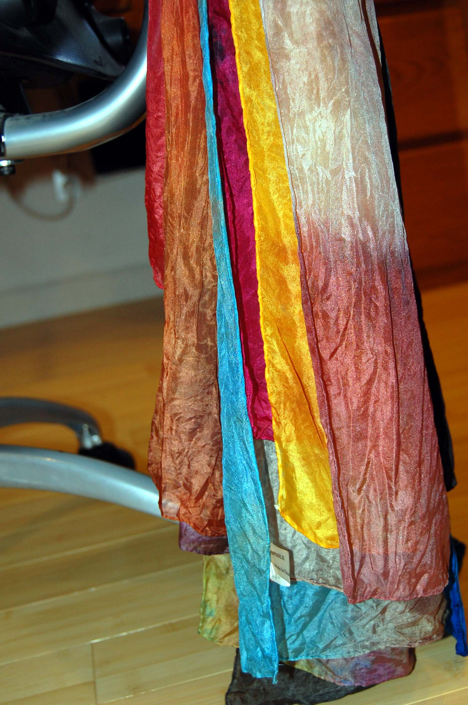 I drape them neatly in case I don't get them all ironsed before the dry. Which is the case this week - 60 scarves is a LOT to iron!